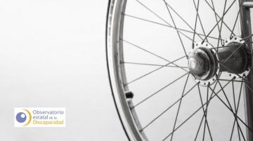 Imagen detalle de una silla de ruedas y logotipo del OED